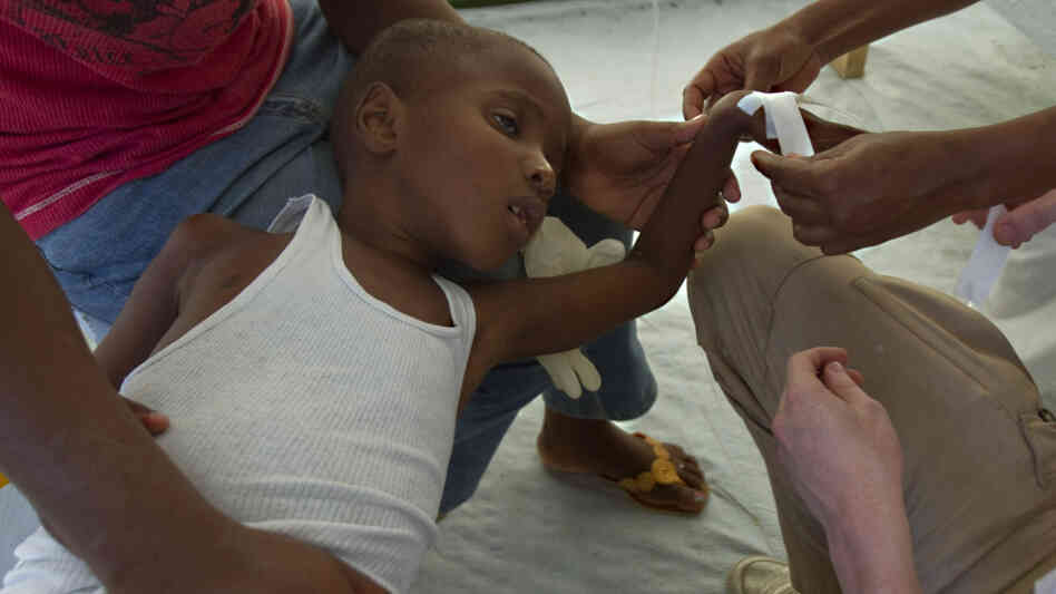 A boy being treated for cholera in Haiti.
