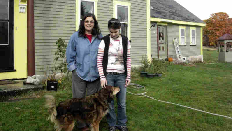Rachel Keyser and her daughter, Sydney, stand in front of their house in Deerfield, N.H.