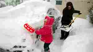 Dec. 2, 2010: Lilly and Tara Schweikhard dig out in Buffalo.