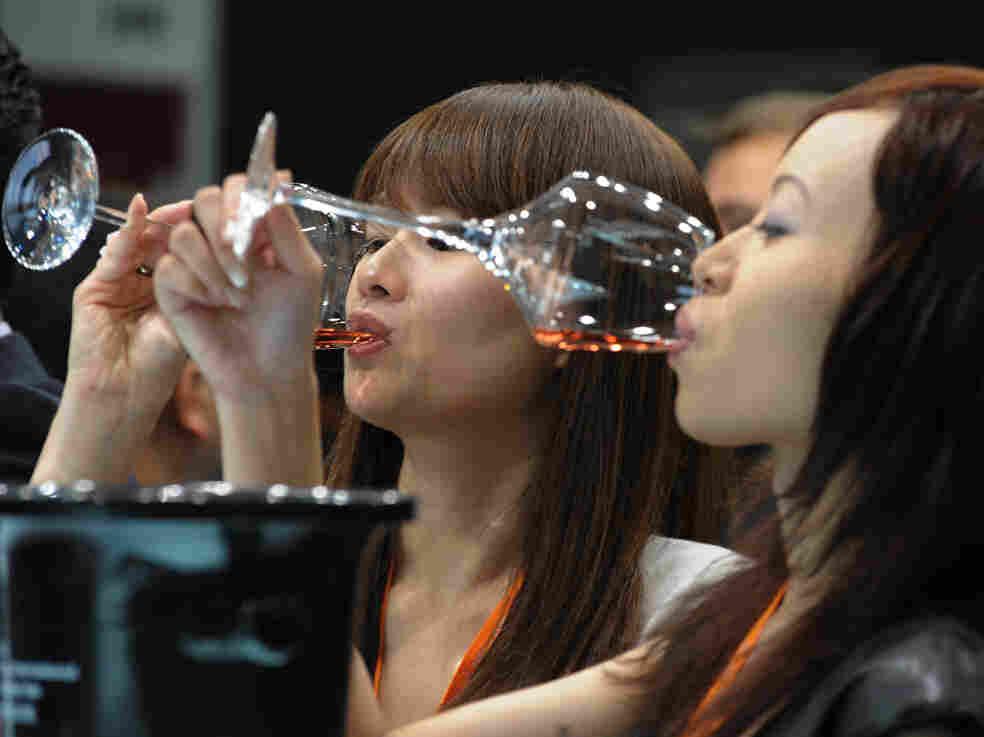 Visitors to the Hong Kong International Wine and Spirits Fair sample wine