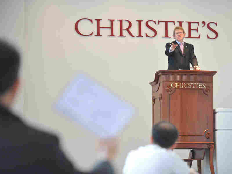 Auctioneer David Elswood during a wine auction in Hong Kong in November