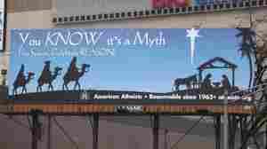 The billboard sponsored by American Atheists. Seth Wenig/AP