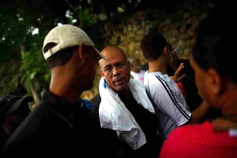 "Michel ""Sweet Mickey"" Martelly greets his supporters at his home in Petionville.  A popular singer in Haiti, Martelly failed to qualify for the runoff, placing third after Manigat and Celestin."