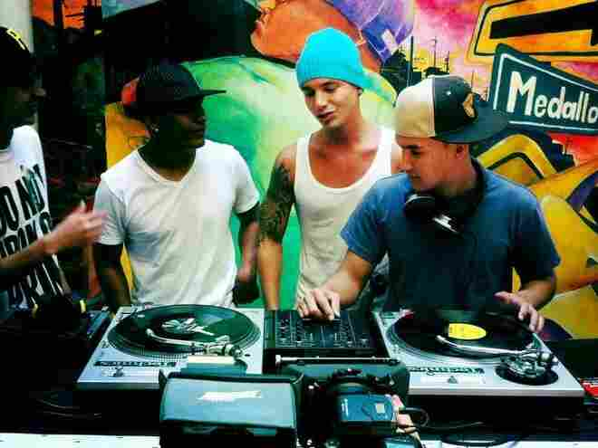 J Balvin, Henry Arteaga and the resident DJ at a recording session in Medellin .