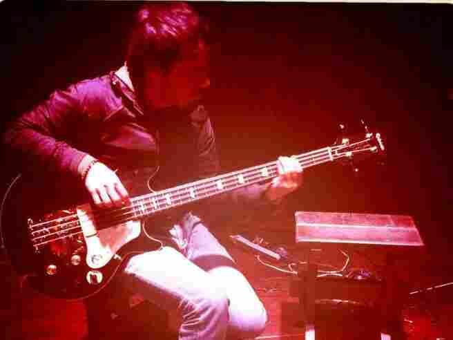 Bomba Estereo's Simon Mejia jamming on the bassBomba Estereo's Simon Mejia jamming on the bass