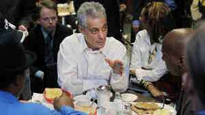 Rahm Emanuel eats at Izola's Restaurant while campaigning for Chicago mayor.
