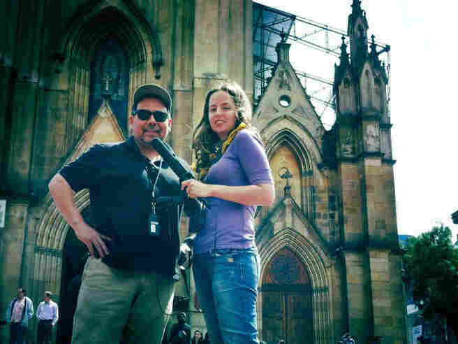 Felix Contreras and Jasmine Garsd looking cool in front of the Lourdes Cathedral in downtown Bogotá.