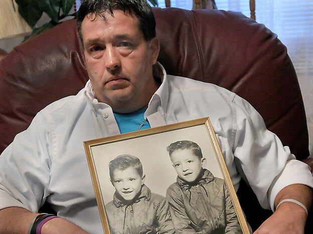 Gene Jones holds a mid-1960's photo of himself, right in photo, and his brother, Dean Jones. Gene's twin brother lost his life in  the Upper Big Branch Coal Mine explosion.