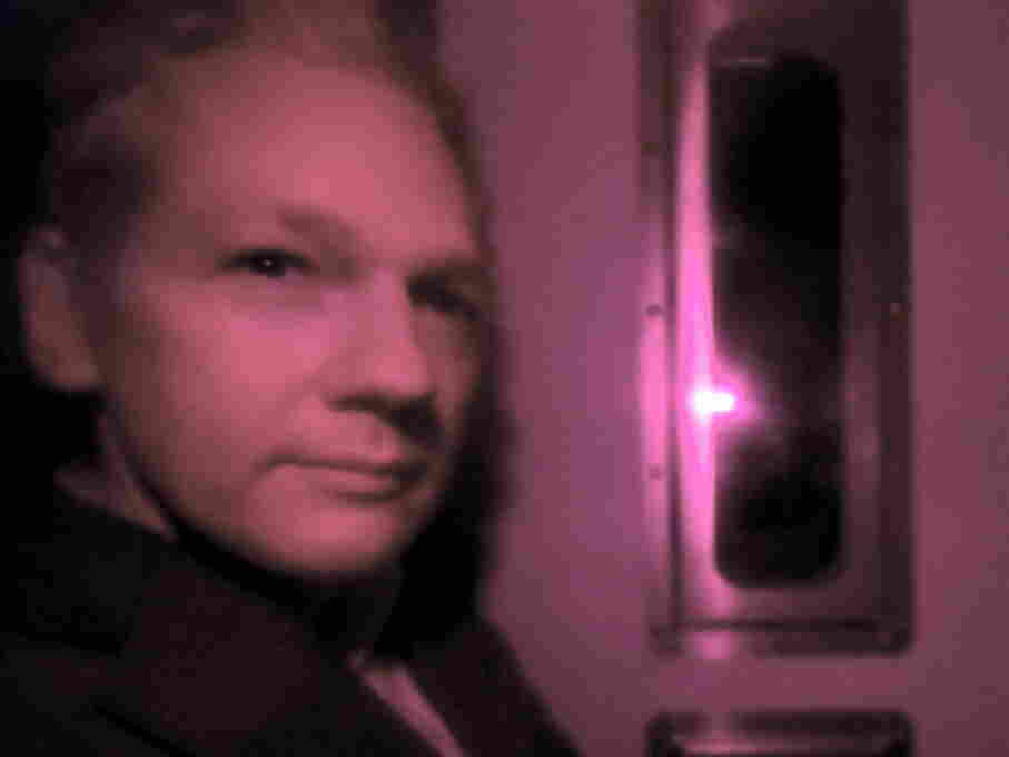 Wikileaks founder Julian Assange, arriving at court in a police van this morning.