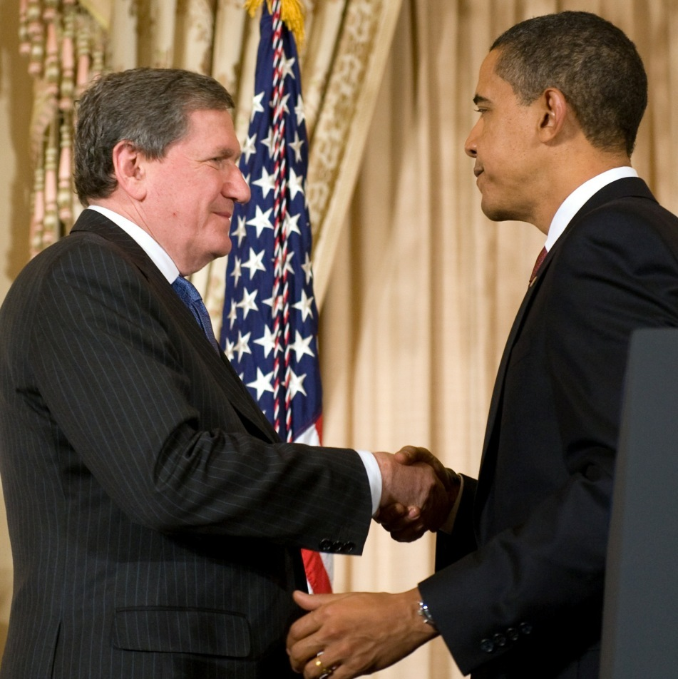 President Obama shakes hands with Ambassador Holbrooke Jan. 22, 2009.