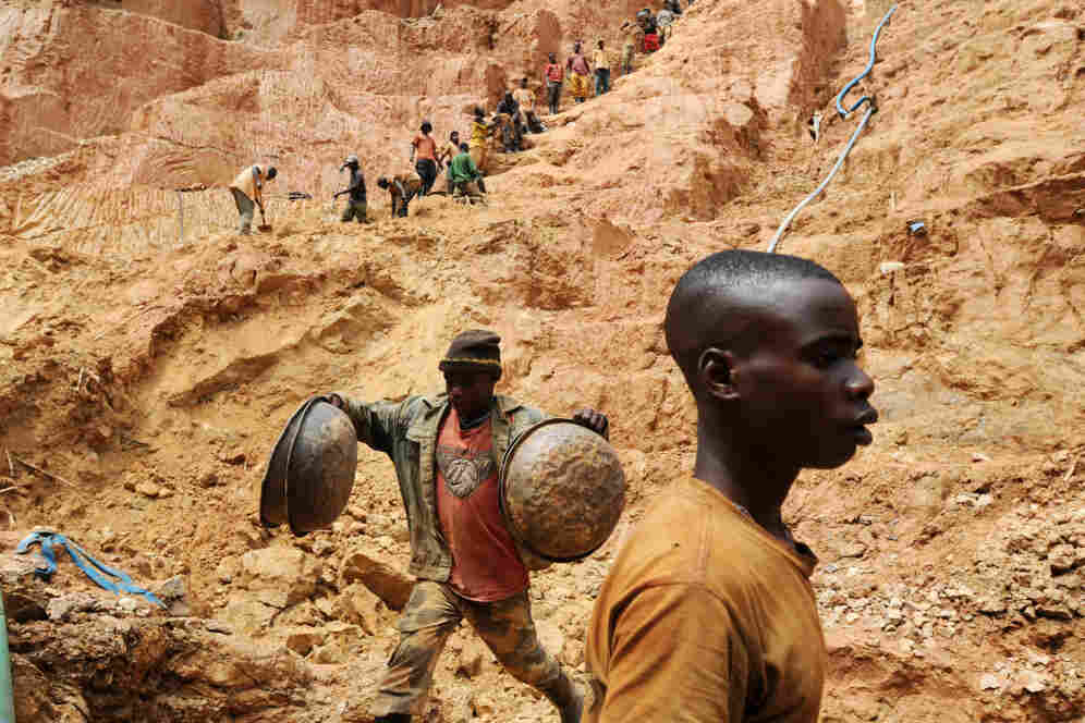 Workers dig at a gold mine in Chudja, near Bunia, northeastern Congo. The conflict in the Congo has often been linked to a struggle for control over its minerals resources.