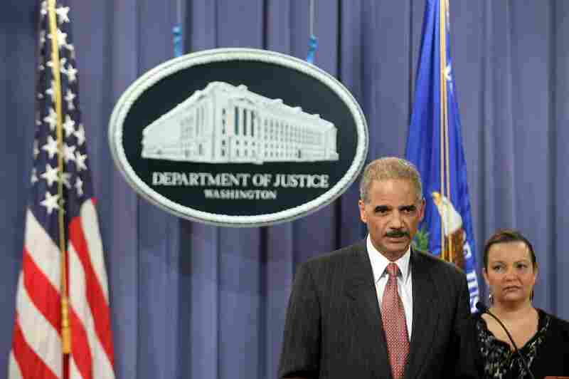 Attorney General Eric Holder announces a civil lawsuit against BP and eight others in an effort to recover billions of dollars from the Gulf oil spill. At right is Environmental Protection Agency Administrator Lisa Jackson.