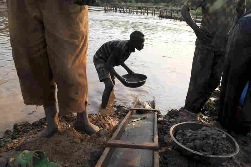 A boy pans for gold in a river in Iga Barriere, northeastern Congo.