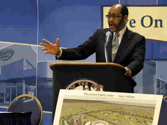 Gary, Ind., Mayor Rudy Clay (right) describes the the proposed $300 million Michael Jackson museum and performing arts center this summer as Joe Jackson, father of the late Michael Jackson, looks on.