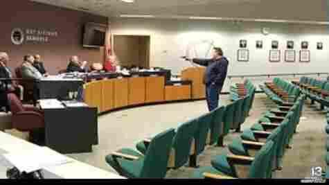 A gunman, identified as Clay Duke, opens fire at a Panama City, Fla., school board meeting.