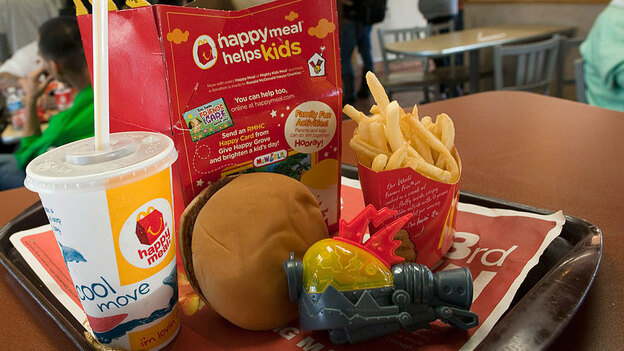 The promise of the latest toy is a big allure for kids at McDonald's (Getty Images)