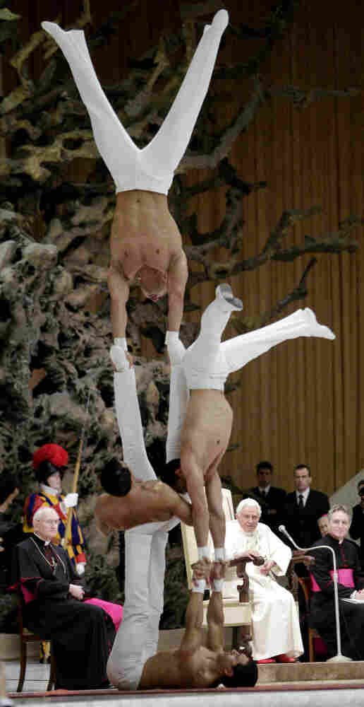 "Acrobats perform in front of Pope Benedict XVI during his weekly general audience at the Vatican. The ""Pellegrini brothers"" acrobatic show lasted just a few minutes."
