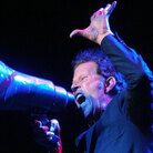 Tom Waits onstage in 2004, six years into his eligibility for induction into the Rock and Roll Hall of Fame.