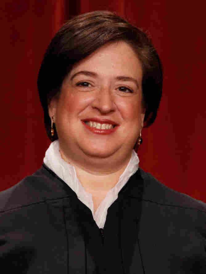 Supreme Court Justice Elena Kagan poses for photographs at the Supreme Court building on Oct. 8.