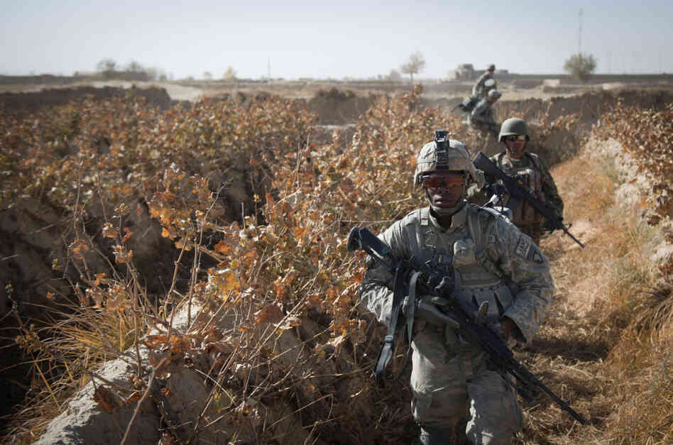 U.S. soldiers patrol around Kop Ahmed camp near Kandahar City in Afghanistan, Nov. 28.
