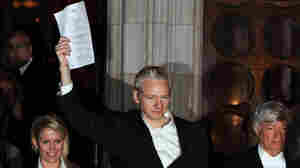 WikiLeaks founder Julian Assange celebrates as he prepares to address the media outside the High Court in central London, on December 16, 2010.