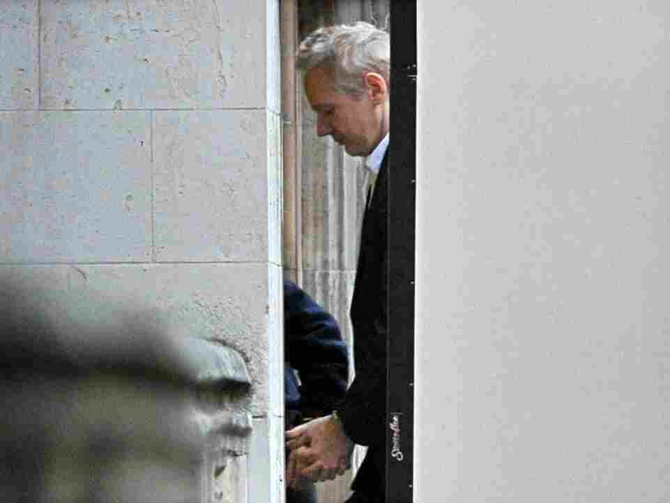 Wikileaks founder Julian Assange is led into London's High Court on December 16, 2010.