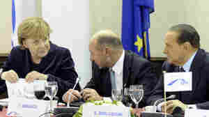 German Chancellor Angela Merkel spoke with Romanian President Traian Basescu (center) and Italian Prime Minister Silvio Berlusconi on Thursday ahead of a two-day EU summit in Brussels, Belgium.