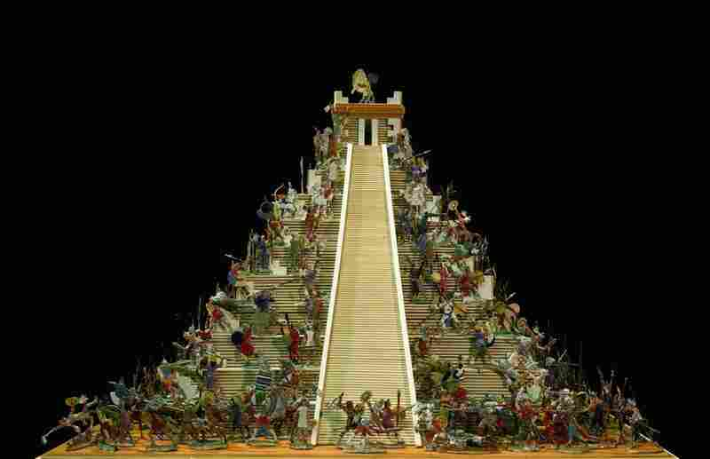 Around the Pyramid of the Sun in Tenochtitlan, today's Mexico City, Aztec warriors in feather regalia and jaguar skins battle against the troops and Indian allies of Hernan Cortes in 1521. This large, intricate set was produced by Aloys Ochel of Germany, the world's largest maker of tin flat figures. Its estimated value is between 2,500 and 3,500 dollars.
