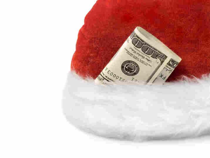 A santa hat with money stuffed in it
