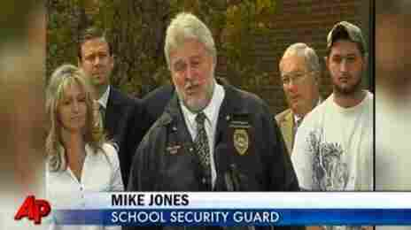 Panama City, Fla., Dec. 16, 2010: Security guard Mike Jones talks to reporters about what happened when a gunman opened fire at a school board meeting.  Jones brought the attacker down with return fire.