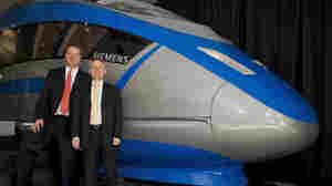 Mock-up of a high-speed-rail train by Siemens, one of the firms in the running for the Florida contract, with Siemens executives Eric Spiegel (left) and Oliver Hauck in Tampa in October.