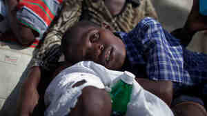 A boy with symptoms of cholera waits for treatment at the St. Catherine hospital in Cite Soleil in Port-au-Prince on Nov. 10, 2010. Cholera has sickened more than 91,000 Haitians and killed more than 2,000.