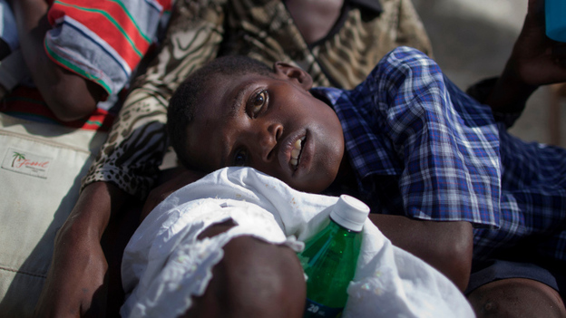 A boy with symptoms of cholera waits for treatment at the St. Catherine hospital in Cite Soleil in Port-au-Prince on Nov. 10, 2010. Cholera has sickened more than 91,000 Haitians and killed more than 2,000. (AP)