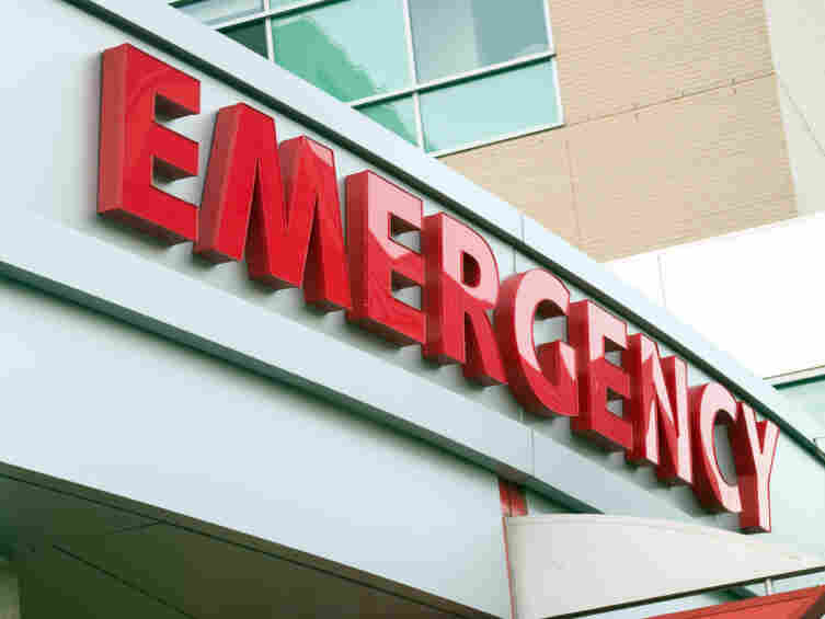 A sign for a hospital emergency room.