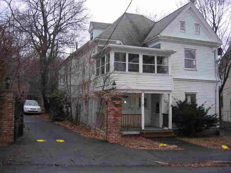 Katty Familia says she saved up for 20 years to buy this green clapboard house in Boston's Hyde Park neighborhood.