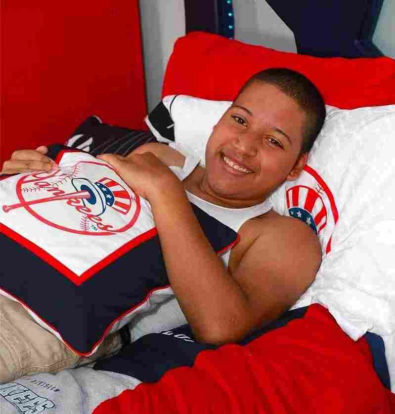 Eighteen-year-old Jesus German relaxes in his newly-transformed, Yankees-themed room in the Bronx. Blissful Bedrooms also arranged for German, who has spina bifida, to go to a Yankees game and meet his hero, Alex Rodriguez.