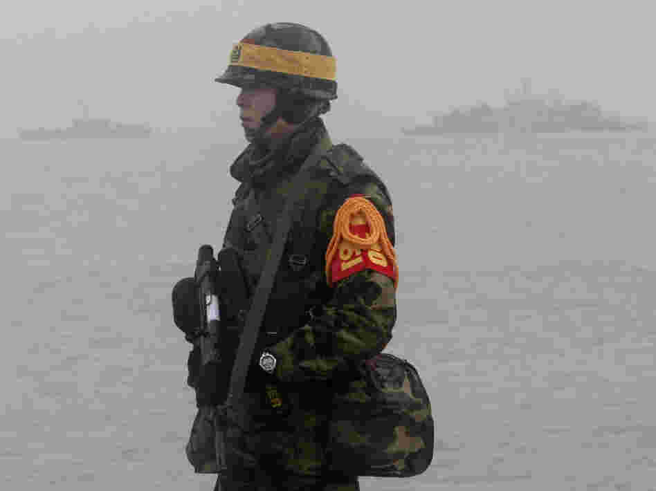 A South Korean marine stands guard on Yeonpyeong island on Friday.