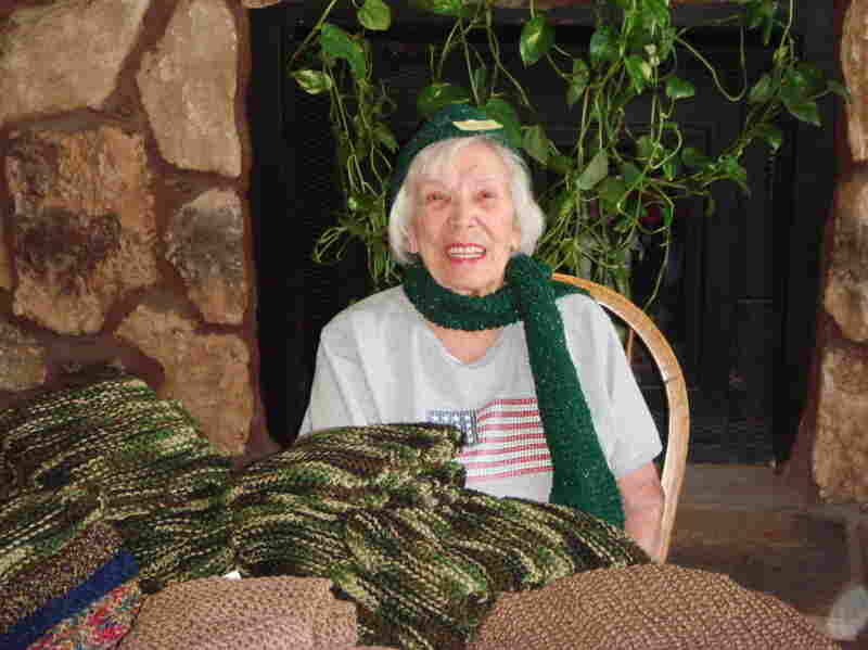 Operation Gratitude volunteer Joan Mazzarelli models one of the hats and scarves she knits for the care packages. Since March, the 98-year-old has knitted 527 scarfs for the troops.