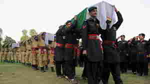 Pakistani soldiers carry coffins of their colleagues during a funeral ceremony in Peshawar on Oct. 22, 2010, following a bomb explosion in the Yakh Kandaw area of Orakzai, one of the districts where Taliban militants have fled after punishing offensives elsewhere in the northwest.