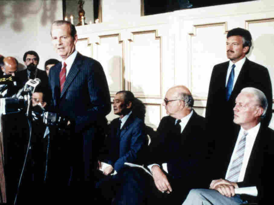 In 1985, David Mulford, far right, watches James Baker announce the Plaza agreement.