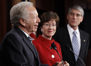 """Sen. Joseph Lieberman (I-CT) left, with Sen. Susan Collins (R-ME) and Sen. Mark Udall (D-CO), talks about the passage of a bill to repeal """"don't ask, don't tell"""" at the Capitol on Saturday."""