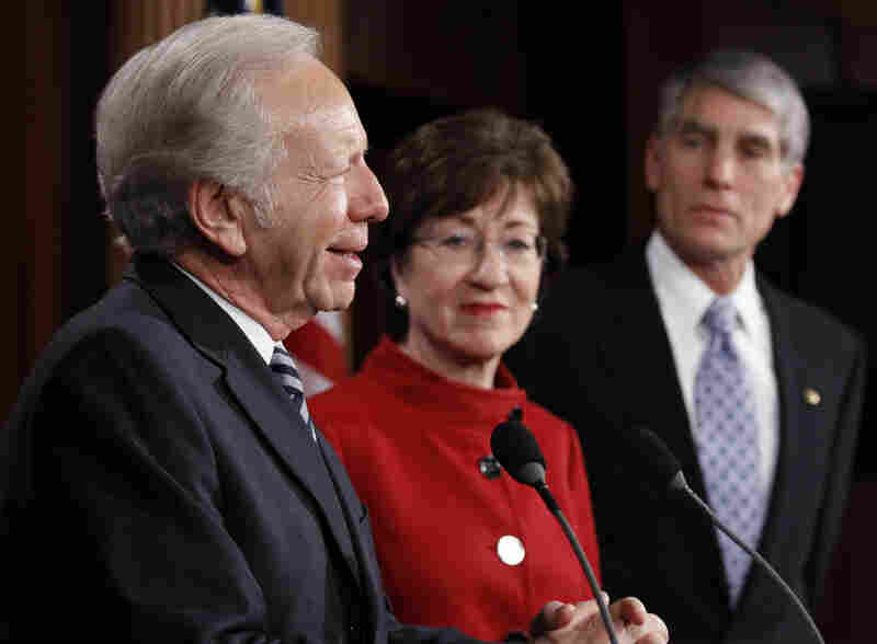 "Sen. Joseph Lieberman (I-CT) left, with Sen. Susan Collins (R-ME) and Sen. Mark Udall (D-CO), talks about the passage of a bill to repeal ""don't ask, don't tell"" at the Capitol on Saturday."