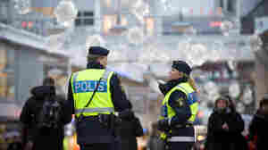 Swedish police officers patrol a street in central Stockholm, near where a suicide bomber killed himself two days earlier, on Dec. 11.