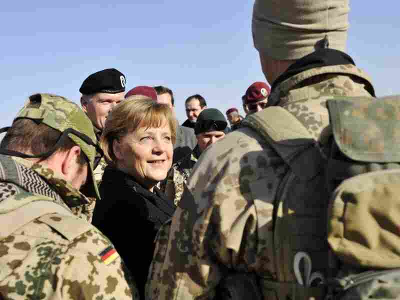 German Chancellor Angela Merkel visits an ISAF soldier camp in Kunduz, Afghanistan. Germany will begin pulling troops out of Afghanistan next year.