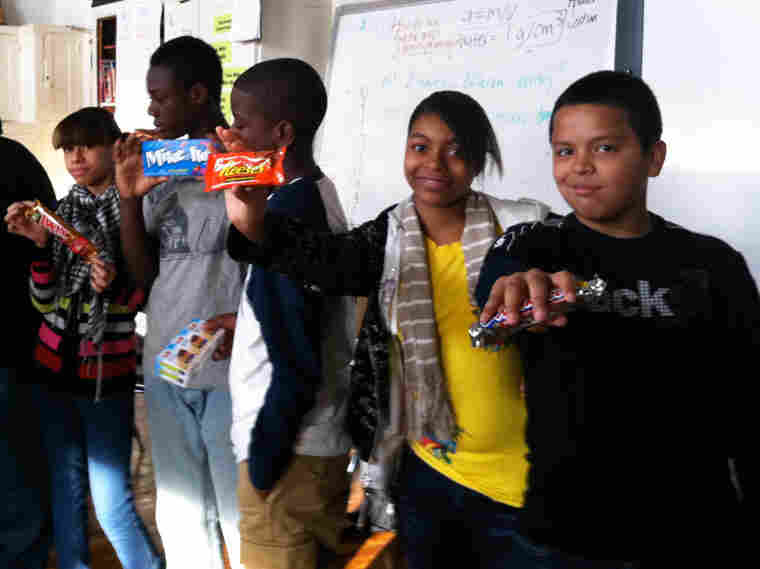 Michael Diaz, Priscilla Clayton, Justin James, Shaheem Turner and Angelica Osorio show off the results of their trades.