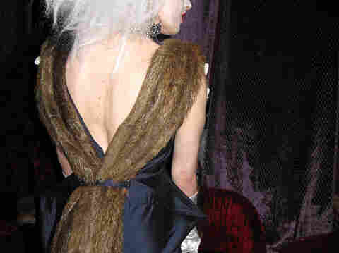 The plunging back of model Paige Morgan's dress is trimmed with nutria tails.  She says she loves the fur and thinks many other people will be thrilled to find there is a guilt-free fur option.