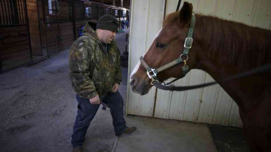 Bobby McKinney, 29, prepares to groom a horse at the Chastain Horse Park in Atlanta.