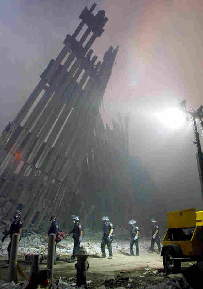Firefighters make their way through the rubble of the World Trade Center in New York on Sept. 11, 2001.