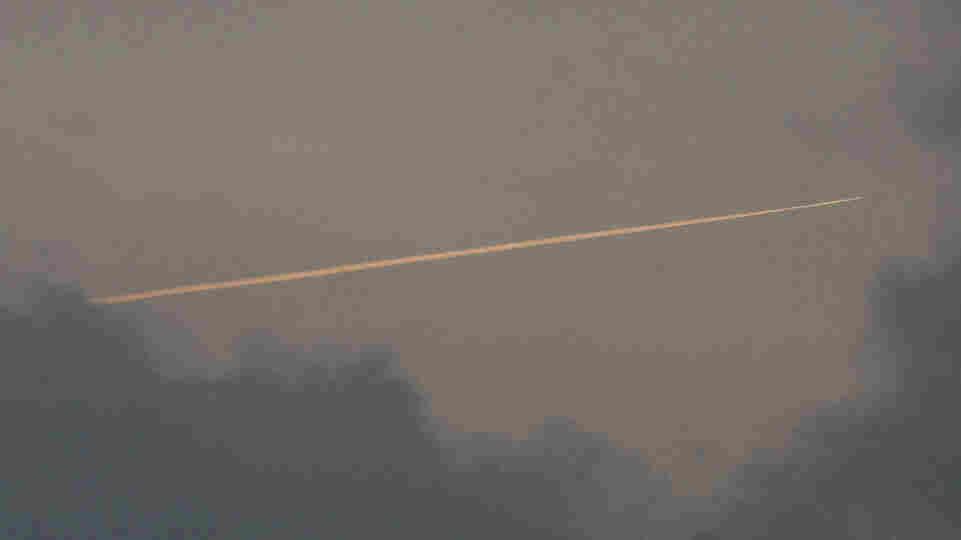 A vapor trail is left by reconnaissance plane over a South Korean island near the disputed Korean border.