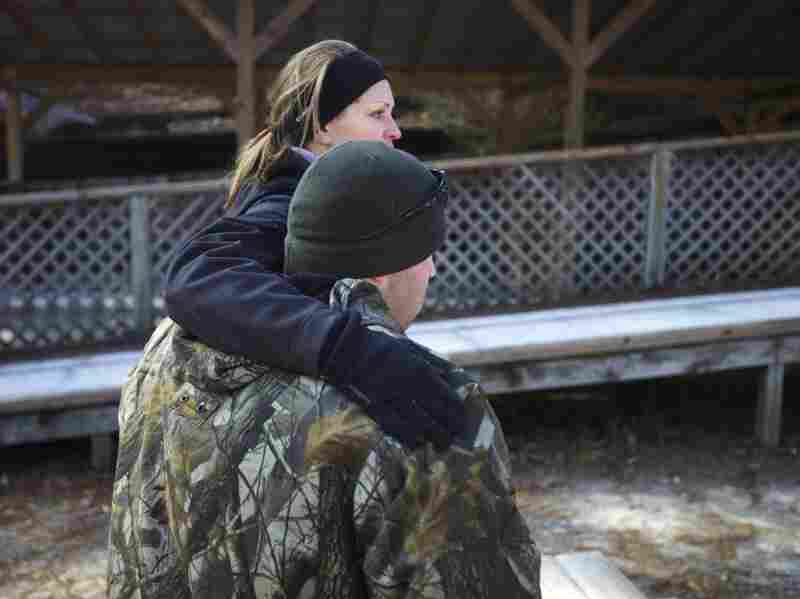Bobby McKinney, 29, hugs Becky Bunnell, an instructor at the Chastain Horse Park with its therapeutic program.
